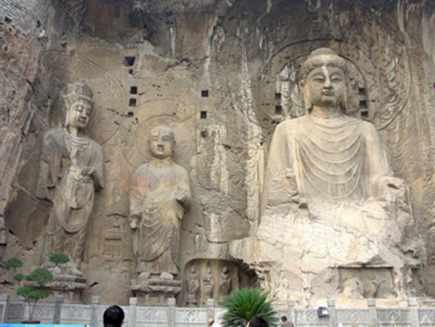 Wu Zetian made Buddhism the official religion. The Fengxian cave of the Longmen Grottoes was commissioned by Wu Zetian; the large, central Buddha is representative of the Vairocana. (G41rn8 / CC BY-SA 4.0)