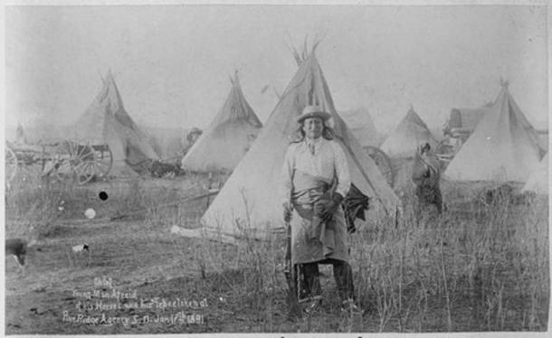Young-Man-Afraid-of-His-Horses (Tashun-Kakokipa), an Oglala Sioux; standing in front of his lodge, Pine Ridge, South Dakota. (Public Domain)