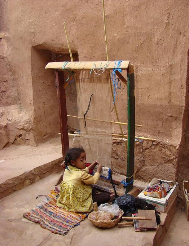 Young girl working on a loom in Ait-Ben-Haddou