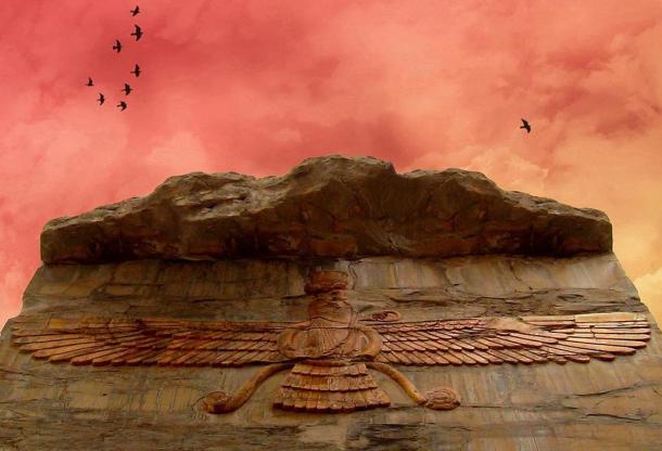 Beautiful photograph of Zoroastrian symbolic carving, viewed under a stunning red sky, Farvahar. Persepolis, Iran.