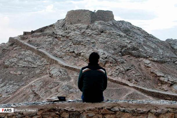A lone modern Zoroastrian at Dakhmeh Zartoshtian (Zoroastrian Towers of Silence) in Yazd, Iran. (Fars News Agency / CC BY 4.0)