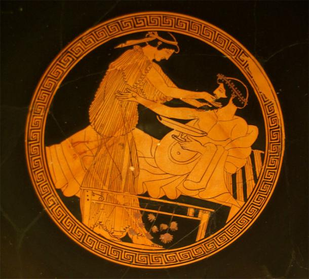 A scene from the interior bowl of a red-figure kylix or stemmed drinking cup (490-480 BC) depicting a Greek man and a hetairai (high-class prostitute). (Sebastià Giralt / CC BY-NC-SA)