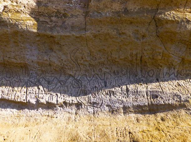 """The abstract petroglyphs carved on the cliff walls are distinctly different from other types of rock art found throughout California. They are said to 'tell a story' but the precise details are not publicly known."""