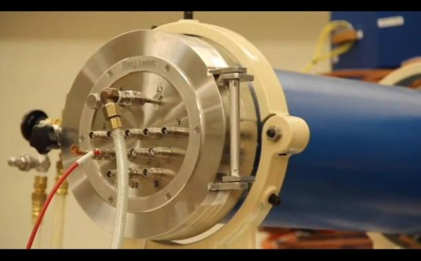 Screenshot of YouTube video showing scientists discussing their accelerator mass spectrometer that is dating layers of earth around fossils and tools in Sterkfontein Caves in South Africa.