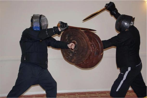 Photo from the actualistic weapon tests (final stance of the fifth play), where the researchers are acting out possible Bronze Age warfare fighting techniques.            Source: (R. Herman et al. / Journal of Archaeological Method and Theory)