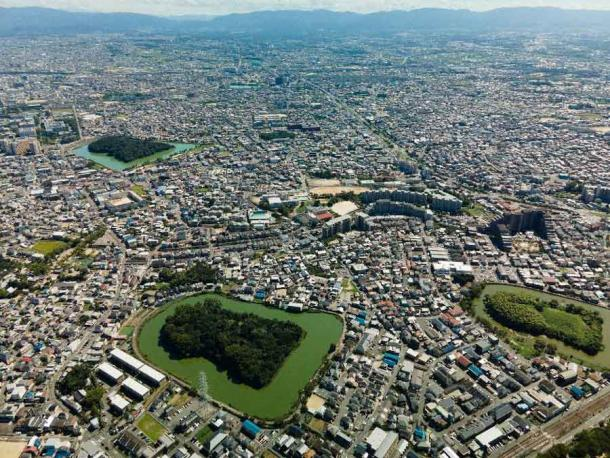 An aerial view of the Mozu-Furuichi Kofun Group, a group of one hundred and twenty-three kofun or tumuli in Fujiidera and Habikino, Osaka Prefecture, Japan. Thirty-one of the burial mounds are keyhole-shaped, thirty round, forty-eight rectangular, and a further fourteen are of indeterminate shape. (Claude Jin / Adobe Stock)