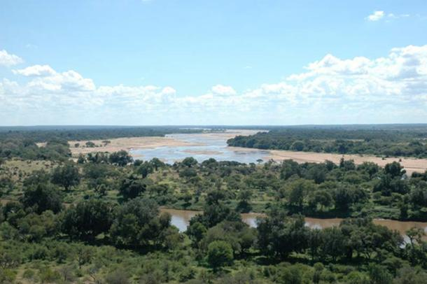 Taken from South Africa, to the left is Botswana and Zimbabwe is on the right. The river running from left to right is the Limpopo River. The river which disappears on the horizon is the Shashe.