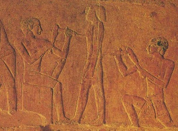 Ancient Egyptian sculptors making a statue.
