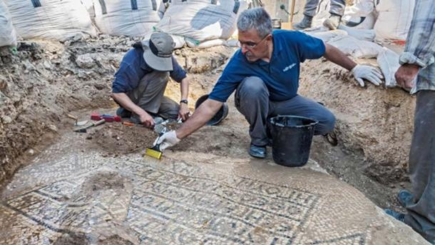 An ancient Greek inscription mentioning the Byzantine emperor Justinian was found at the Jerusalem Old City Damascus Gate, August 2017 (Assaf Peretz, Israel Antiquities Authority)