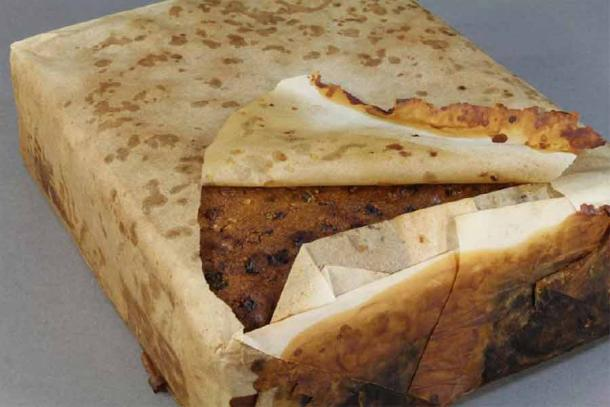 100-year-old fruitcake found amongst almost 1,500 artifacts conserved from a group of buildings at Cape Adare in the Antarctic. It was probably left behind by Scott's Terra Nova expedition. (Antarctic Heritage Trust)