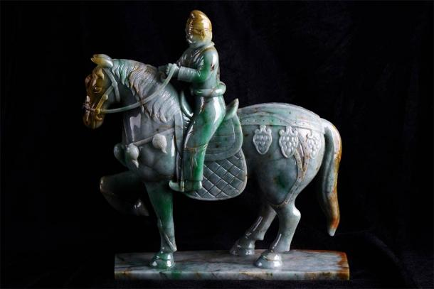 An ancient Chinese jade carving of a mounted warrior horseback riding in China. (bbbar / Adobe Stock)