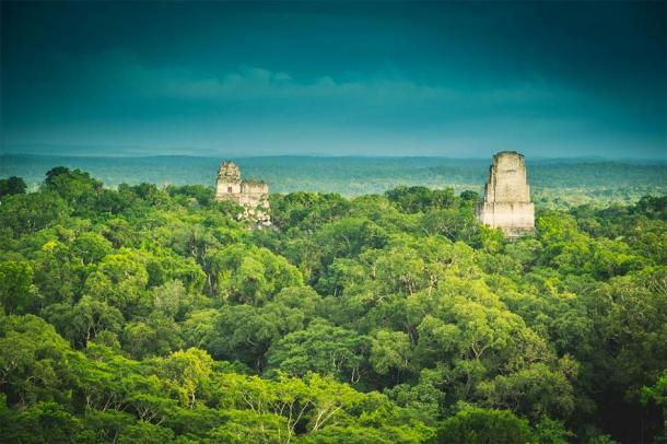 The ancient city of Tikal rises above the rainforest in northern Guatemala. (Ai /Adobe Stock)