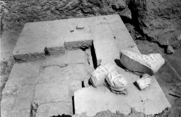 An area within the ancient healing temple with fragments from a statue. Greek Ministry of Culture