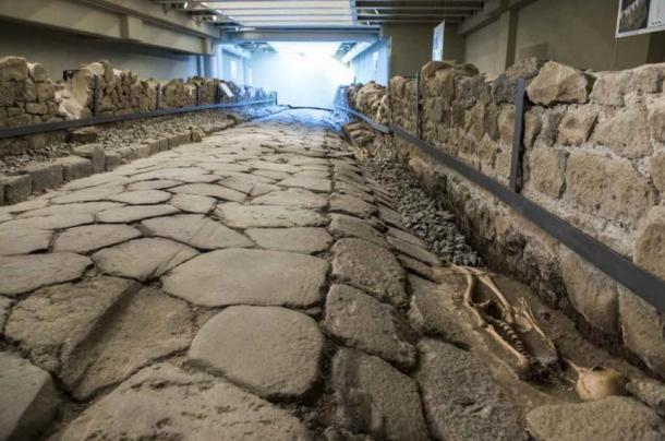 The ancient road beneath a new McDonald's in Italy.