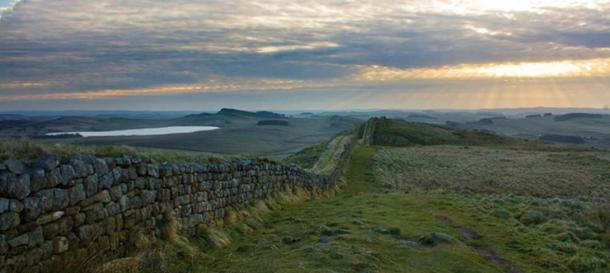 The ancient site of Vindolanda is located just south of Hadrian's Wall (pictured), which it predates.