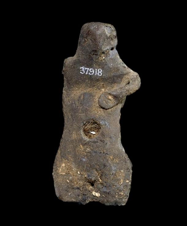 Ancient wax figure with human hair pushed into the navel, and an inscription embedded in the back