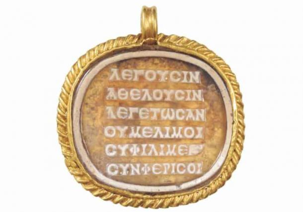 The ancient Greek 'stressed' poem inscribed on a cameo on a medallion of glass paste (2nd to 3rd century AD). (BHM Aquincum Museum and Archaeological Park / Péter Komjáthy /Cambridge Classical Journal)