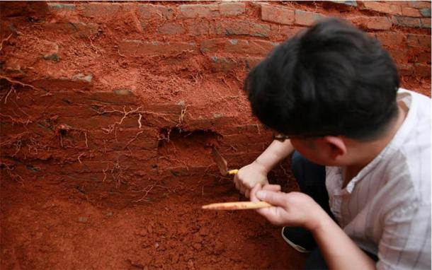 An archaeologist works at the excavation site of the ancient Chinese couple's tomb dating back to the Northern Song Dynasty (960-1127) in Nanfentang Village, Batang Township, Ningxiang City, central China's Hunan Province, May 17, 2020. (Xinhua / Liu Jing)