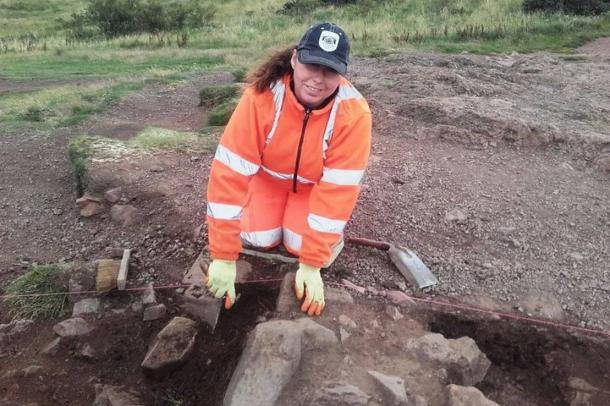An archaeologist at work unearthing the ancient Edinburgh hillfort recently uncovered on Arthur's Seat, in the heart of the Scottish capital city