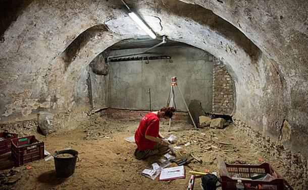 An archaeologist works at the site