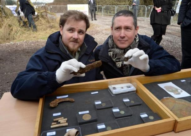 Archaeologists Kevin Mooney and Warren Bailie with some of the artifacts.