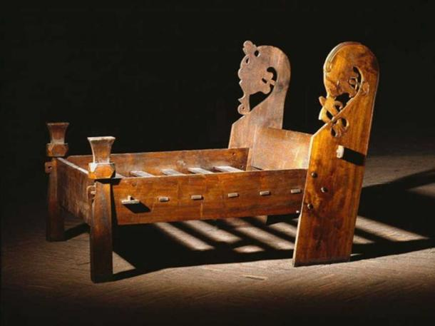 Copy of the bed found in the Oseberg ship burial chamber where two elderly women were found lying next to each other.