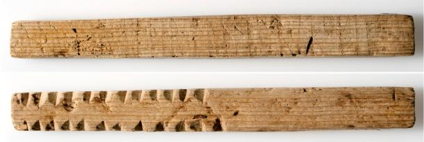 """Romantic runic inscription and control notches: """"Please love me"""" on one side and notches on the other, probably showing the number of sacks or barrels that were unloaded or loaded on merchant ships. The wooden stick is about 11 centimeters (4.3 inches) long. (Image: Svein Skare, University Museum of Bergen)."""