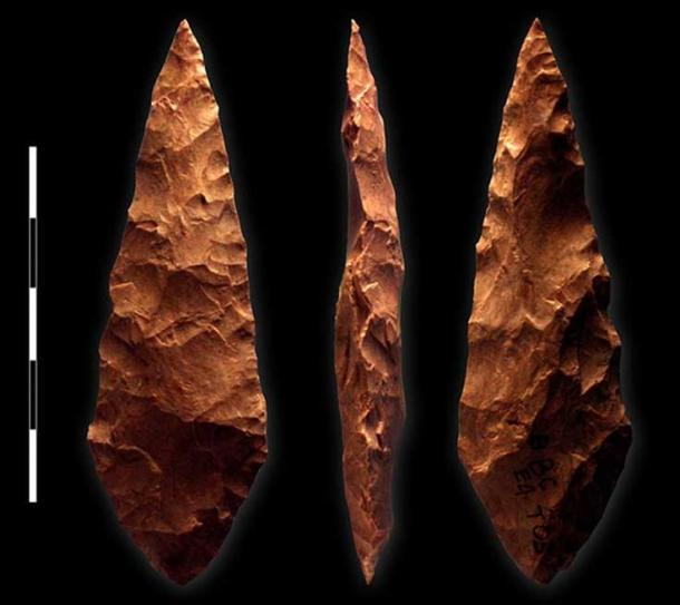 Example of bifacial silcrete point from M1 phase (71,000 BC) layer of Blombos Cave, South Africa; scale bar = 5 cm.