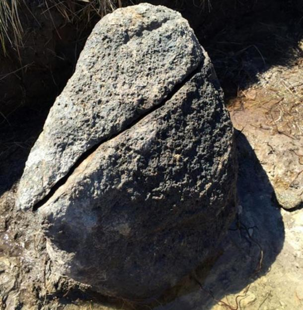 A blackened rock said to be the hearth. Slag was found around the boulder.