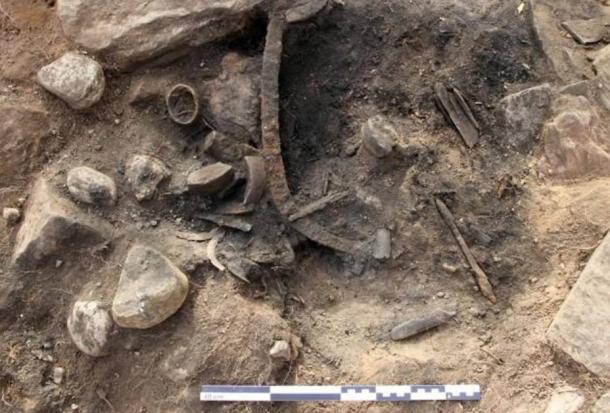Along with blacksmithing tools, personal items were found in the grave, such as clothing, scissors, and tweezers.