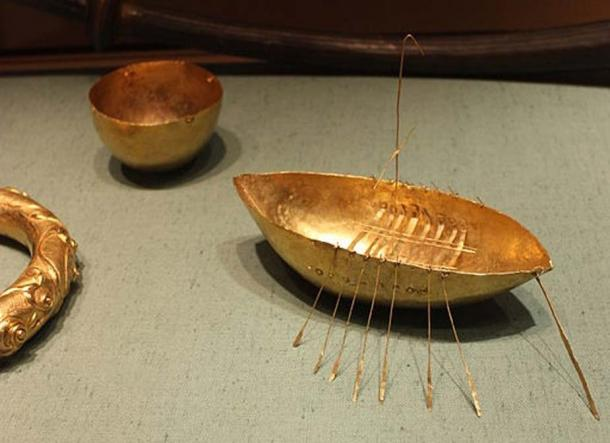 The boat, bowl, and part of a torc.