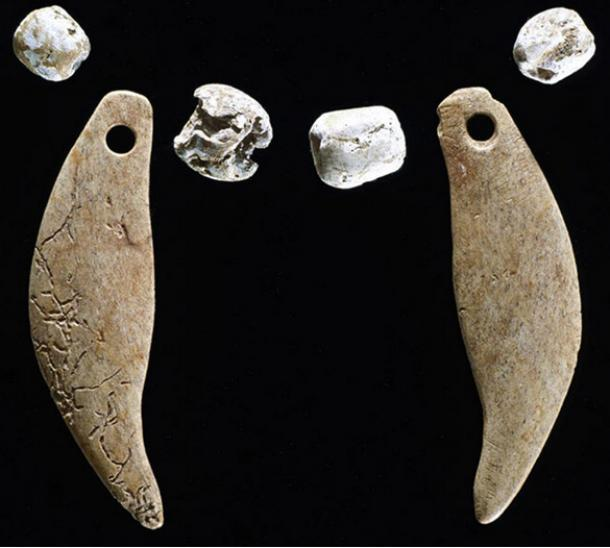 Ancient Native Americans buried these bone pendants and shell beads together with the bobcat.