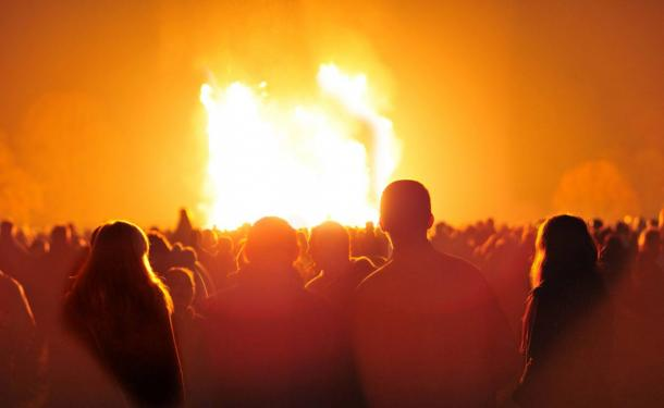 Spectators gather around a bonfire on 6 November 2010, Staffordshire, England.