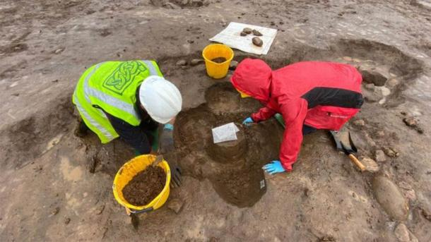 How the Bronze Age burial urn was found in the ground, upside down. (Fadó Archaeology)