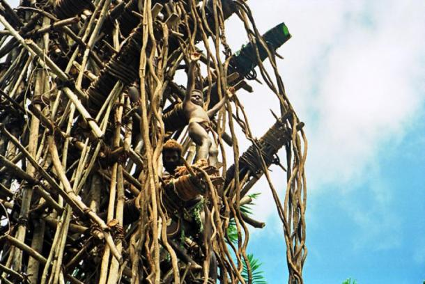 A boy contestant at the top of the rickety tower about to jump during the land diving ceremony on the Pentecost Island, Vanuatu. (Paul Stein / CC BY-SA 2.0)