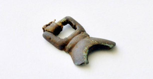 One of the bronze artifacts recovered from the 1,000-year-old Alaska house.