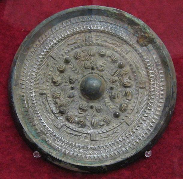 Another bronze mirror found in Japan. This example dates to the Kofun period.