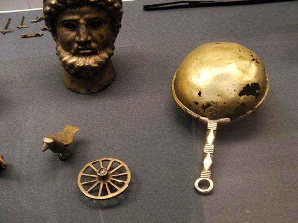 Ancient Roman bronze rattle that was used for religious rites against demons.
