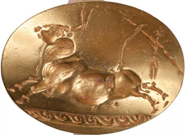 A ring showing a bull which was found in the tomb of the Griffin Warrior.