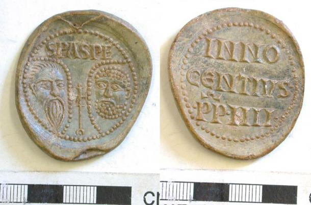 Lead papal bulla of Pope Innocent IV (1243-54). (CC BY SA 2.0) One face bears the conventional stamped busts of Saints Peter and Paul both within drop-shaped pelleted borders, possibly haloes. On the reverse are the words INNOCENTIVS PP IIII. The PP stands for Pastor Pastorum, meaning shepherd of the shepherds.