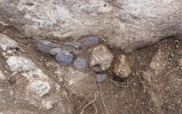 The cache of silver coins were found in a rock crevice.