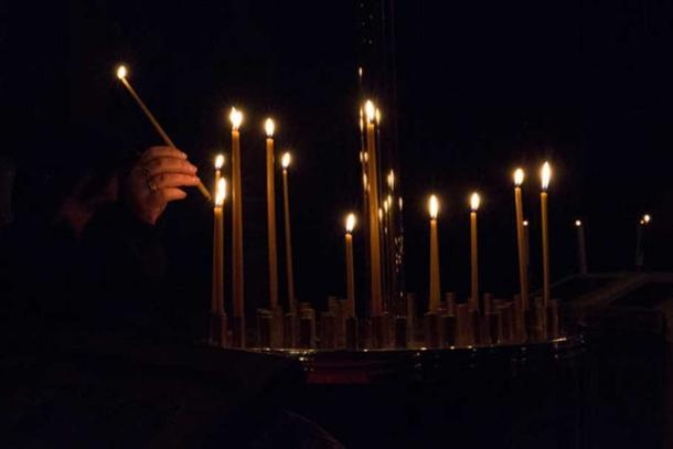 People lighting candles on All Saints' Day. Reuters/Philippe Wojazer