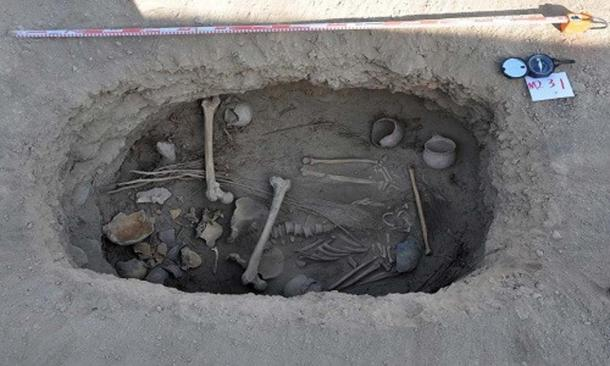 """The grave of the man found with a """"cannabis shroud"""" in the Jiayi cemetery, China."""