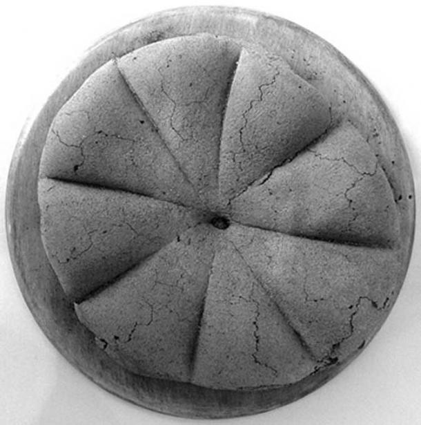 A carbonized loaf of ancient Roman bread from Pompeii.
