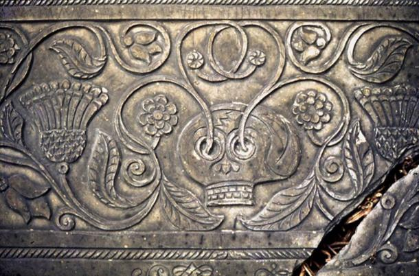 Elaborately carved grave slab at Shebbear (Devon, England) showing a skull sprouting flowering shoots