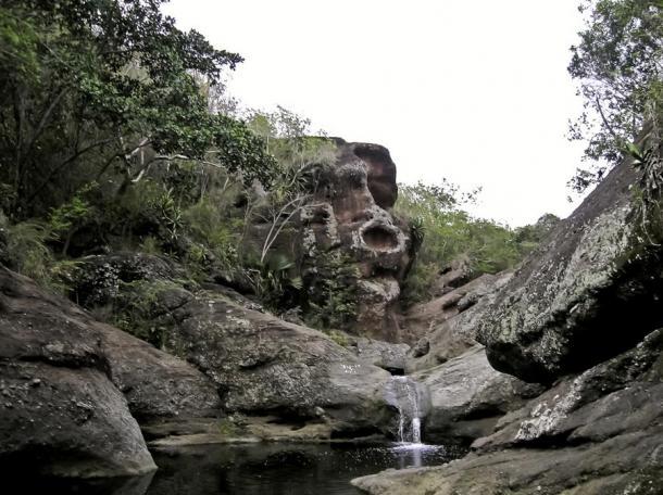 Massive carved-stone face of Taino god Cohoba.