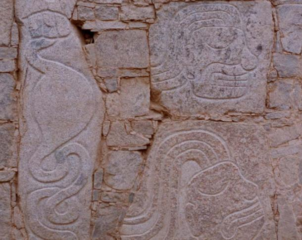 The carving on the left depicts a stomach and intestines