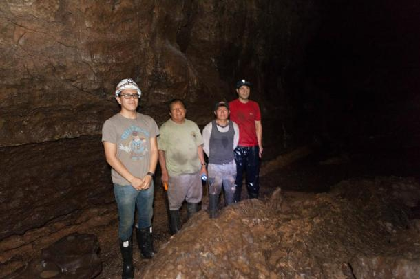 Exploring the cave on the 4th day, Chris and Gary with two of the guides.