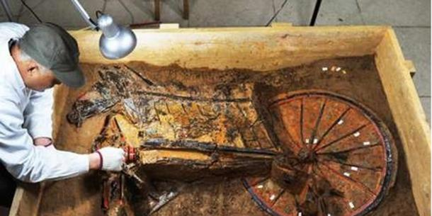 A chariot from the tomb being cleaned.