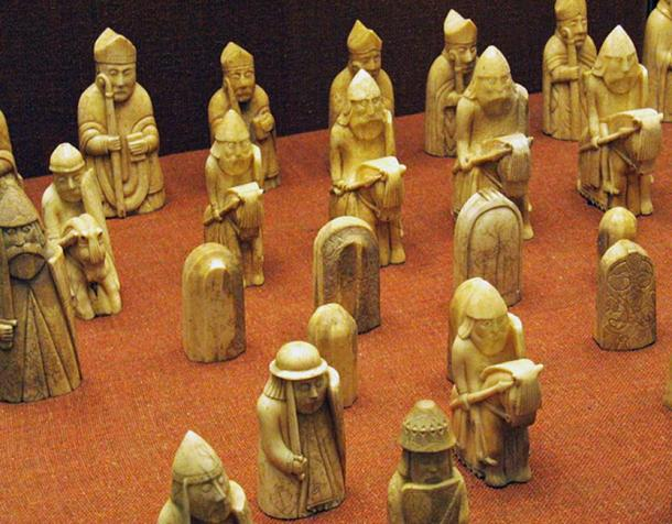 A selection of chess pieces, with a row of Bishops at the back, then a row of Knights.